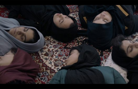 Girls in Iranian filmmaker Mehrdad Oskouei's Sunless Shadows (2019) which shows a group of girls in a reformatory lying down on a carpet during a meditation session